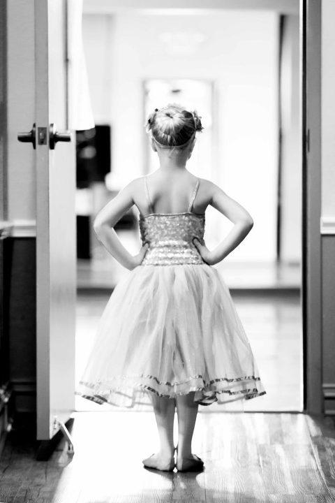 tiny dancer posed in doorway