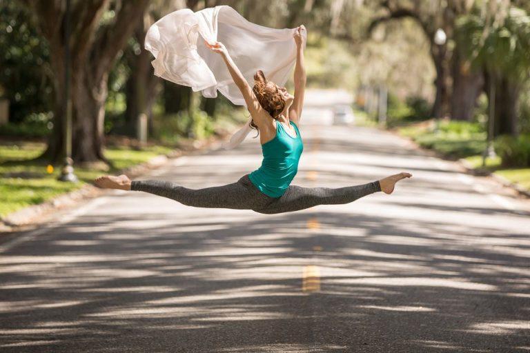 senior leaping in street in ocala photo